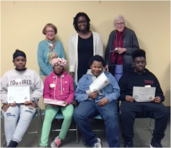Student writing award recipients, teacher, and tutors